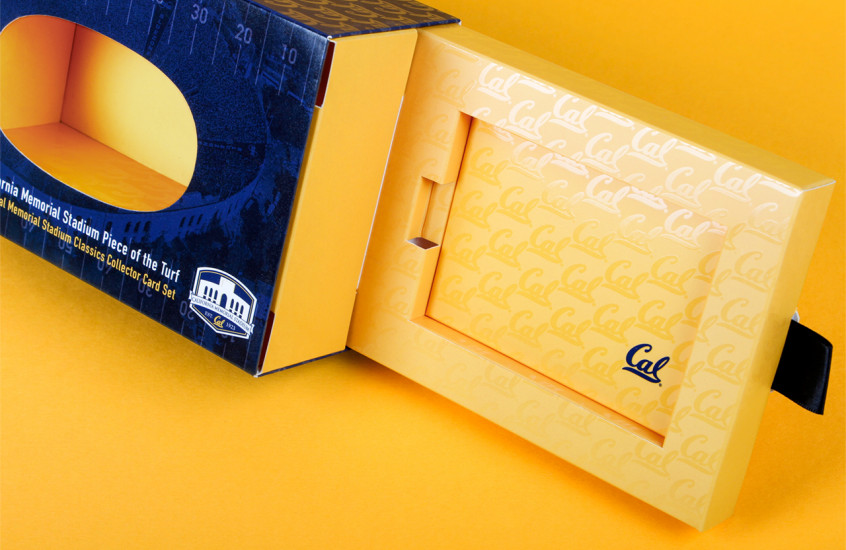 California Golden Bears Football - Collectible Merchandise — Displayed in a highly finished pack, our clever reveal for the California Golden Bears football team held a piece of the original stadium turf and set of trading cards, completing the presentation for this prized collectors piece.