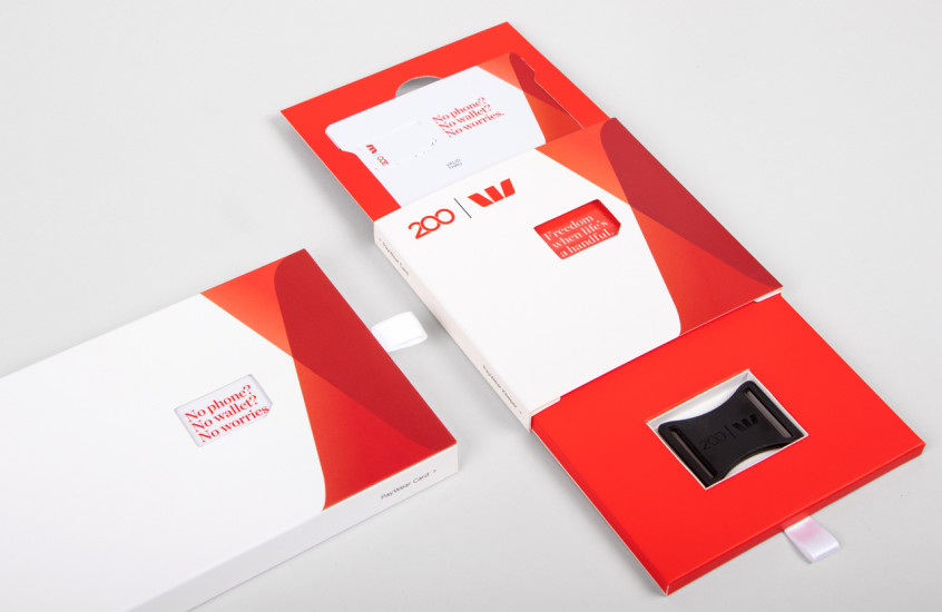 Westpac - PayWear — Packaging that presents both a card and a wearable in a unique way. The diecut window in the cover brings an animated and clever element to the design.