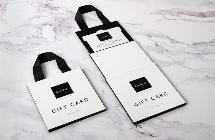 Hotel Chocolat - Gift Card — Gift card packaging with writable messaging areas and a ribbon handle.